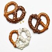 Three pretzels dipped in white and dark chocolate