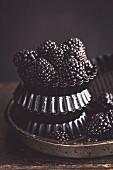 Blackberries in metal dishes