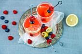 Raspberry lemonade with fruit kebabs