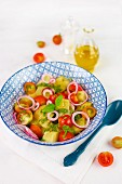 Potato salad with cherry tomatoes, tropea onions and pesto