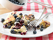 Kaiserschmarrn (shredded sugared pancake from Austria) with oats and fresh blueberries