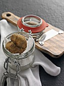 White truffles on paper in a flip-top jar