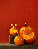 Three Halloween pumpkins with scary faces