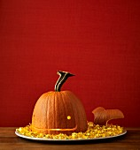 A Halloween pumpkin on a tray carved as a whale