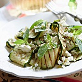 Grilled courgette with cheese, edible flowers and herbs