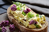 Bread with egg salad and purple carnations