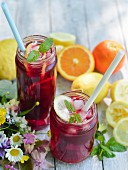 Fruity iced tea with slices of orange and lemon.