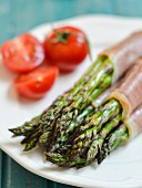 Baked asparagus wrapped in ham