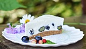 A slice of unbaked blueberry yoghurt cake