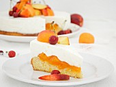 A sliced yoghurt cake with apricots and cherries