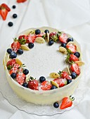 White chocolate mousse cake with strawberries and coconut