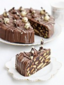 A sliced chocolate & biscuit cake