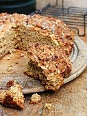 Rustic soda bread on a wooden plate