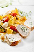 Chicken breast stuffed with goats' cheese served with tagliatelle