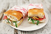 Focaccia sandwiches with tomato, cheese, rocket and turkey breast