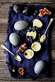 White chocolate ice cream with blueberries and figs in eggshells