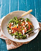 Sharon fruit, watercress, feta and nut salad