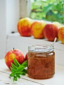 Apple and mint jam in a glass jar