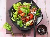 Vegetable salad with red rice, tomato, mangetout and spinach