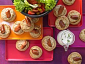 Savoury buns with sausage and salad