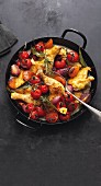 Braised chicken with vine tomatoes, apricots and saffron