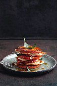 A polenta, tomato, pork escalope and ham tower