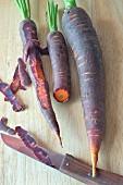 Purple carrots on a chopping board