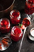 Strawberry jam being filled into jars