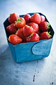 Strawberries in a blue cardboard box