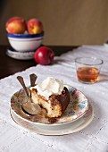 A slice of peach upside down cake with cream