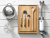 Assorted kitchen utensils for preparing porridge