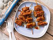 Pork fillet rolls on a kebab