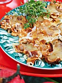 Jerusalem artichoke crisps topped with melted cheese
