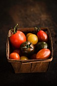 Colourful tomatoes in a basket