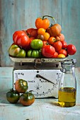 A variety of tomatoes on a kitchen scale
