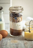 Layered ingredients for making cookies in a preserving jar as a gift
