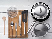 Kitchen utensils for preparing kale with gammon and pan-fried potatoes