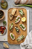 Assorted bruschetta on a chopping board