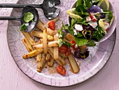 Grilled asparagus with a colourful herb salad