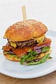 A burger in a potato bun