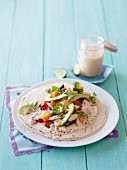 Chicken, vegetable and feta cheese wraps with a spicy yoghurt sauce
