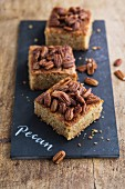 Three slices of pecan nut tray bake cake