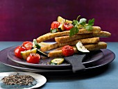 Pan-fried slices of toast with courgette and cherry tomatoes