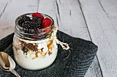 Muesli with fresh berries in a screw-top jar