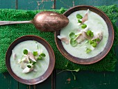 Herb and potato soup with fillet of trout