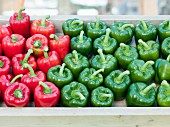 Red and green peppers in a wooden tray