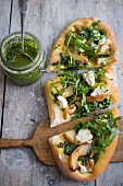 Vegan pizza with pear, rocket, pesto and walnut