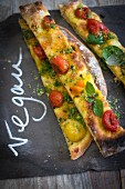 Vegan pizza with caramelised tomatoes and basil salt