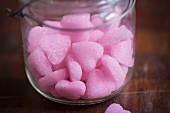 Pink sugar hearts in a glass jar