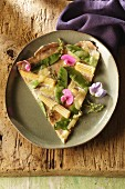 Tarte flambėe with mangetout and mini sweetcorn